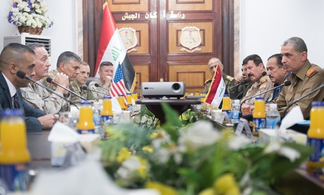 Joint Chiefs Chairman Gen. Joe Dunford, second from left, and Lt. Gen. Stephen Townsend, the top ISIS war commander, meet with Iraqi chief of defense Lt. Gen. Othman al-Ghanimi, in Baghdad, Nov 9, 2016.