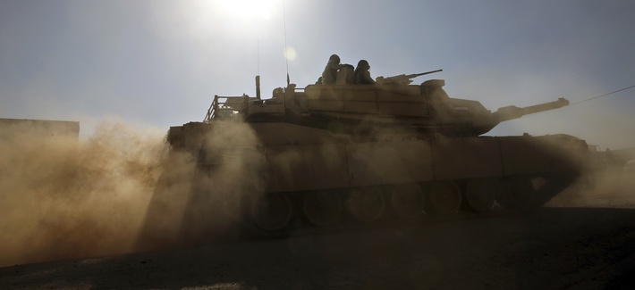 Iraqi special forces soldiers ride a tank past the Samah front line neighborhood, in Mosul, Iraq, Thursday, Nov. 24, 2016.