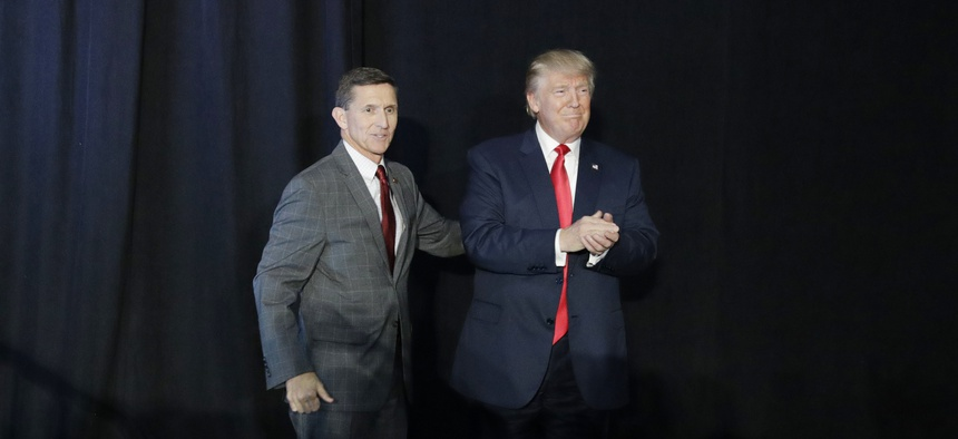 Retired Gen. Michael Flynn, left, introduces then-Republican presidential candidate Donald Trump at a campaign rally, Thursday, Sept. 29, 2016, in Bedford, N.H.
