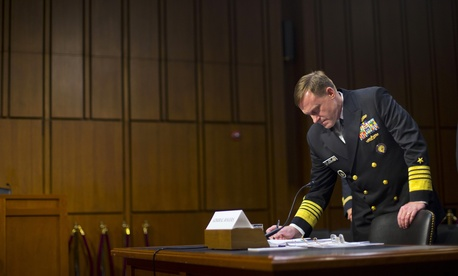 Director of the National Security Agency (NSA) Adm. Michael Rogers takes notes on Capitol Hill, Thursday, Sept. 24, 2015, prior to testifying before the Senate Intelligence Committee.