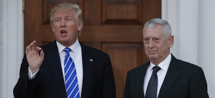 President-elect Donald Trump talks to the media as he stands with retired Marine Corps Gen. James Mattis at the Trump National Golf Club Bedminster clubhouse in Bedminster, N.J., Saturday, Nov. 19, 2016.