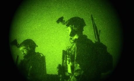 Thursday, Oct. 29, 2009 file photo taken with a night vision scope, U.S. Special Operations forces engage in a joint operation with Afghan National Army soldiers.