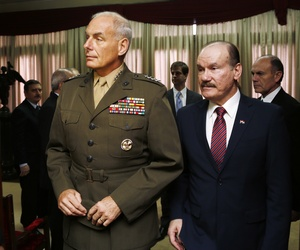 U.S. Marine Gen. John F. Kelly, commander of U.S. Southern Command, arrives for a press conference accompanied by Paraguay's Defense Minister Gen. Bernardino Soto, in Asuncion, Paraguay, Wednesday, July 30, 2014.