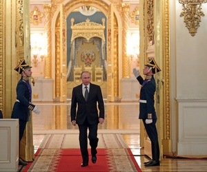 Russian President Vladimir Putin enters a hall to attend a reception marking Heroes of the Fatherland Day in the Kremlin in Moscow, Russia, Friday, Dec. 9, 2016.