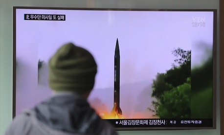 A man watches a TV news program showing a file image of missile launch conducted by North Korea, at the Seoul Railway Station in Seoul, South Korea, Thursday, Oct. 20, 2016.