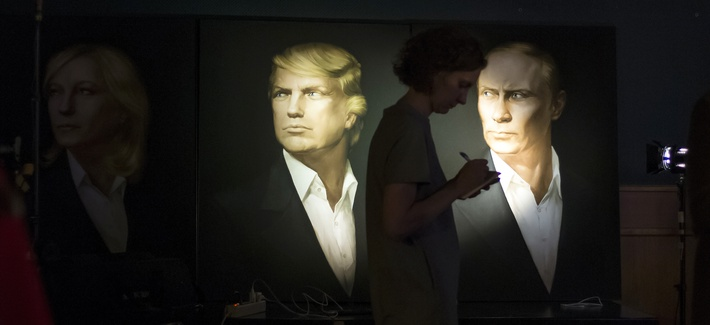 A woman passes by portraits of U.S. presidential candidate Donald Trump and Russian President Vladimir Putin in the Union Jack pub in Moscow, Russia, Wednesday, Nov. 9, 2016.