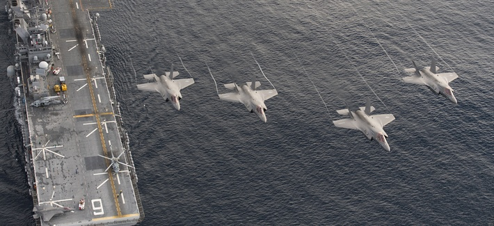 F-35Bs fly over the USS America earlier this year during sea trials.