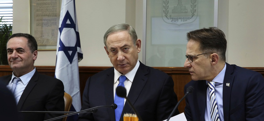 Israeli Prime Minister Benjamin Netanyahu, center, opens the weekly cabinet meeting at his Jerusalem office on Sunday, Dec. 4, 2016.