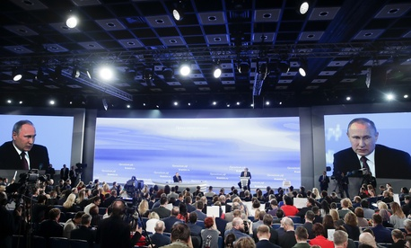 Russian President Vladimir Putin, center back, speaks during his annual news conference in Moscow, Russia, Friday, Dec. 23, 2016.