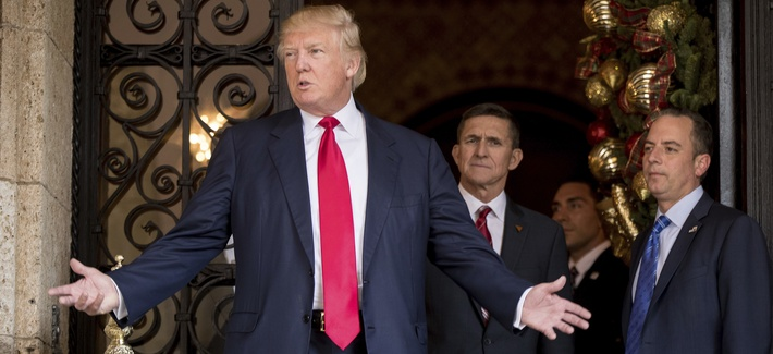 President-elect Donald Trump, left, accompanied by retired Lt. Gen. Michael Flynn, center, at Mar-a-Lago, in Palm Beach, Fla., Wed, Dec. 21, 2016.
