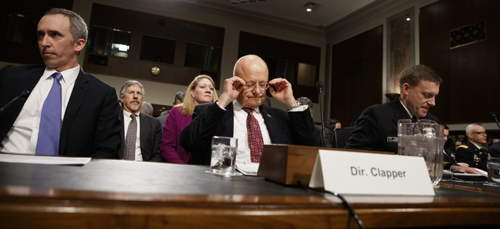 Director of National Intelligence James Clapper, center, Defense Undersecretary for Intelligence Marcel Lettre II, left, and National Security Agency and Cyber Command chief Adm. Michael Rogers prepare to testify on Capitol Hill, Jan. 5, 2016.