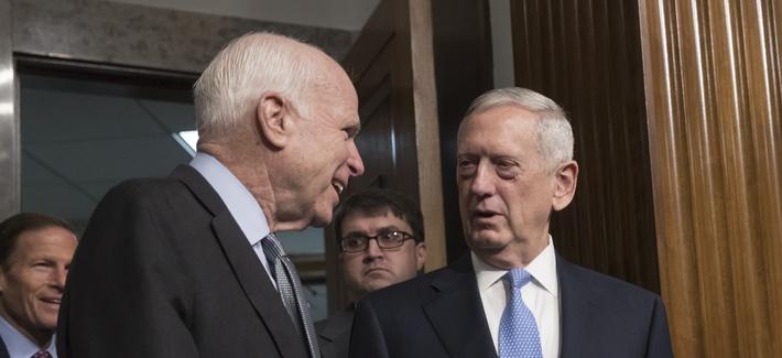 Senate Armed Services Committee Chairman Sen. John McCain, R-Ariz., left, welcomes Defense Secretary-designate James Mattis on Capitol Hill in Washington, Thursday, Jan. 12, 2017.
