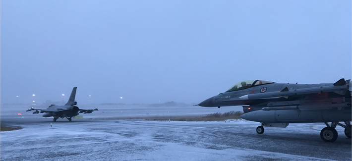 Two Norwegian Air Force jets taxi onto the runway at Bodø, Norway, in a demonstration of their ability to get airborne in less than 15 minutes.