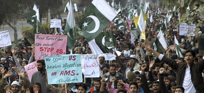 Supporters of Pakistani religious parties chant anti-American slogans during a rally in Lahore, Pakistan, Sunday, Jan. 8, 2017.
