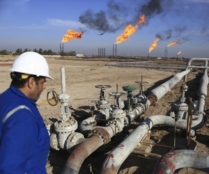 An Iraqi worker worker prepares to operate valves in Nihran Bin Omar field north of Basra, 340 miles (550 kilometers) southeast of Baghdad, Iraq, Thursday, Jan. 12, 2017.