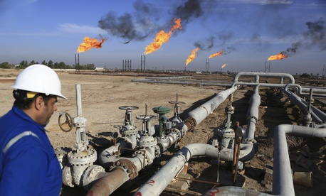 An Iraqi worker worker prepares to operate valves in Nihran Bin Omar field north of Basra, 340 miles (550 kilometers) southeast of Baghdad, Iraq, Thursday, Jan. 12, 2017.