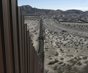 A truck drives near the Mexico-US border fence, on the Mexican side, separating the towns of Anapra, Mexico and Sunland Park, New Mexico, Wednesday, Jan. 25, 2017