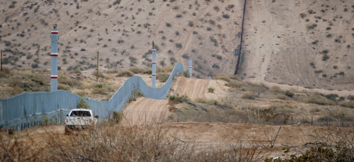 A U.S. Border Patrol agent drives near the U.S.-Mexico border fence in Sunland Park, N.M. in 2016.