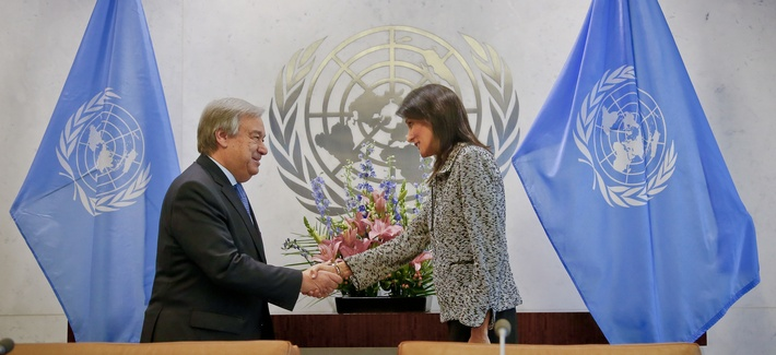 Former South Carolina Governor Nikki Haley, right, shake hands with United Nations Secretary General Antonio Guterres, left, after presenting him with her credentials as the new U.S. Ambassador to the United Nations, Jan. 27, 2017, at the UN.