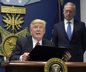 President Donald Trump, left, with Defense Secretary James Mattis, right, watching, explains the executive action on extreme vetting that he is about to sign at the Pentagon in Washington, Friday, Jan. 27, 2017.