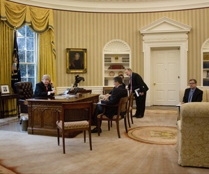 President Donald Trump, left, and National Security Adviser Michael Flynn, second from left, press secretary Sean Spicer, right, and Senior Advisor to the President Jared Kushner, speaks on the phone with Saudi Arabia's King Salman, Jan. 29, 2017.
