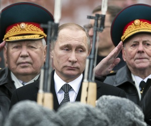 Russian President Vladimir Putin, center, attend a wreath-laying ceremony at the Tomb of the Unknown Soldier in Moscow, Russia, Tuesday, Feb. 23, 2016.