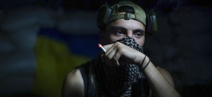 In this photo taken on Friday, Aug. 26, 2016, a Ukrainian soldier smokes in the village of Marinka, near Donetsk, eastern Ukraine. More than 9,500 people have been killed in the fighting that began in April 2014, according to United Nations figures,