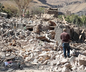 A man walks amid the rubble of a house destroyed by a Saudi-led airstrike on the outskirts of Sanaa, Yemen, Thursday, Feb. 2.