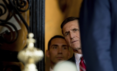 Michael Flynn listens as then-President-elect Trump speaks at Mar-a-Lago, in Palm Beach, Fla., Dec. 21, 2016.