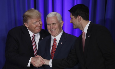 President Donald Trump, accompanied by Vice President Mike Pence, shakes hands with House Speaker Paul Ryan of Wis., Thursday, Jan. 26, 2017, prior to speaking at the Republican congressional retreat in Philadelphia.