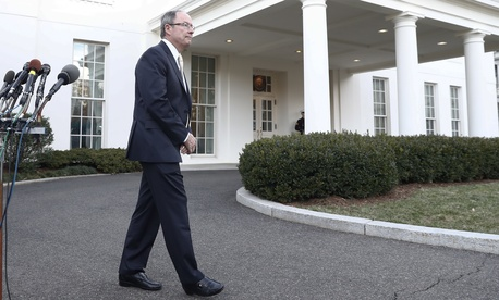 Ret. Gen. Keith Alexander walks from the microphones after speaking to media outside the West Wing of the White House, in Washington, Tuesday, Jan. 31, 2017, after meeting with President Donald Trump and others about cyber security.