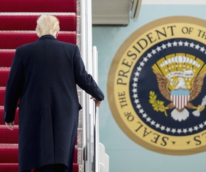 President Donald Trump walks up the steps of Air Force One at Andrews Air Force Base in Md., Friday, Feb. 17, 2017.