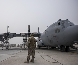 Staff Sgt. Kyle Poston, 455th Expeditionary Aircraft Maintenance Squadron crew chief, oversees engine maintenance on an EC-130 Compass Call Jan. 18, 2017 at Bagram Airfield, Afghanistan.
