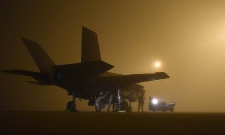 A U.S. Air Force weapons load crew assigned to the 33rd Aircraft Maintenance Squadron loads a live GBU-12 into an F-35A January 18, 2017, at Eglin Air Force Base, Florida.