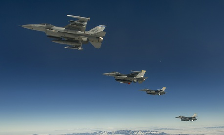 A formation of F-16 Fighting Falcons from the 421st Fighter Squadron, Hill Air Force Base, Utah, depart the snow-laden state en route to San Diego, Calif., Jan. 18, 2013.