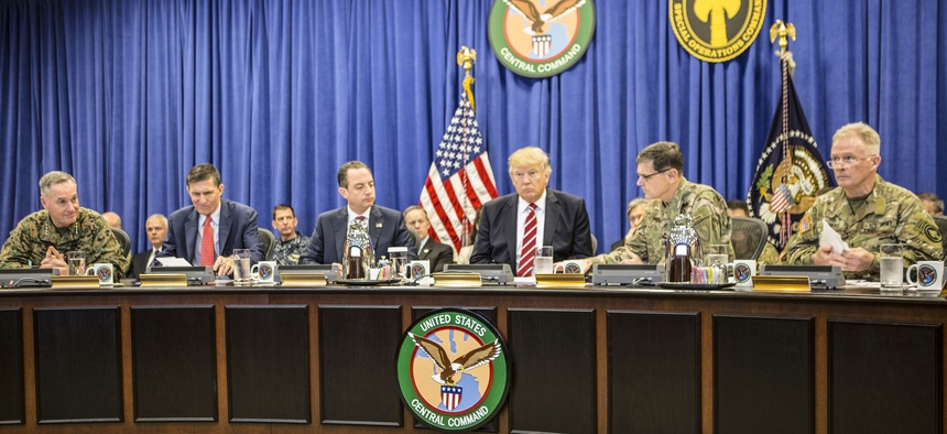 "President Donald Trump with Marine Gen. Joseph F. Dunford Jr., Joint Chiefs chairman; Army Gen. Joseph Votel, CentCom commander; and Gen. Raymond A. ""Tony"" Thomas, SOCOM commander; at USCENTCOM headquarters on MacDill Air Force Base Feb. 6, 2017."