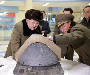 North Korean leader Kim Jong-Un looks at a warhead tip in this photo released by North Korea's Korean Central News Agency.