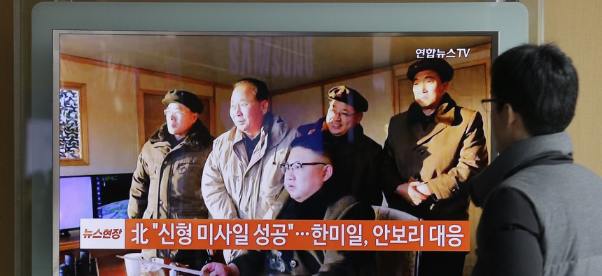 People in Seoul, South Korea watch a TV news program showing North Korean leader Kim Jong Un.
