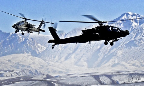 Two Boeing AH-64D Apache helicopters from the 1st Air Cavalry Brigade, 1st Cavalry Division.