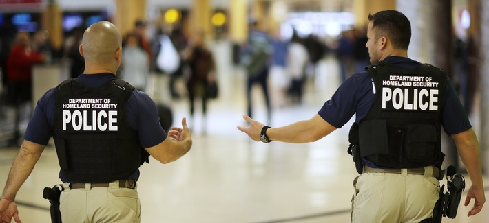 Department of Homeland Security police officers walk through Hartsfield–Jackson Atlanta International Airport ahead of the Thanksgiving holiday in 2015.
