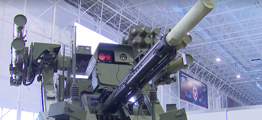 """n armed ground tank robot called the Vikhr, or """"Whirlwind,"""" on display at the 2nd annual Military & Scientific Robotic Conference at Patriot Center in Moscow."""