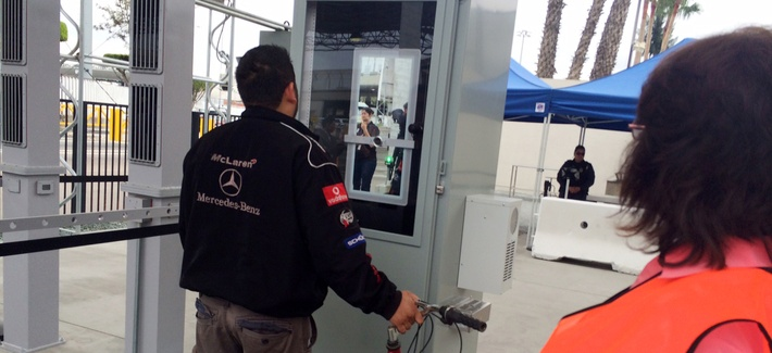 A Tijuana truck driver stands at a machine that captured images of his iris and facial features to verify his documents while leaving San Diego on his way to Mexico on Thursday, Feb. 18, 2016.