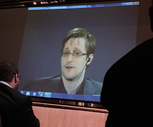 Former National Security Agency contractor Edward Snowden speaks via video conference to Johns Hopkins University, in Baltimore, Feb, 17, 2016.