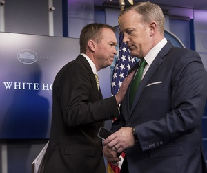 White House press secretary Sean Spicer, right, give the podium to Budget Director Mick Mulvaney during daily press briefing at the White House in Washington, Thursday, March 16, 2017, where he spoke about the Trump Administration's budget proposals.