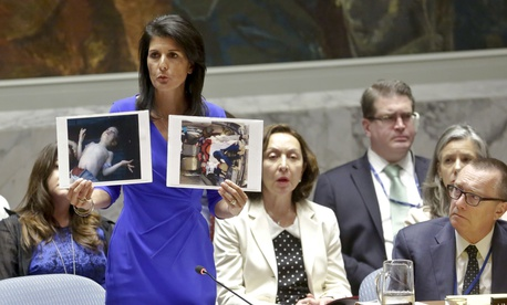 Nikki Haley, United States' Ambassador United Nations, shows pictures of Syrian victims of chemical attacks as she addresses a meeting of the Security Council on Syria at U.N. headquarters, Wednesday, April 5, 2017.
