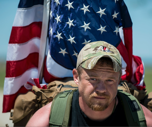 Army veteran Justin Vititoe marches in the Chicago Honor the Fallen Ruck March on May 22, 2015.