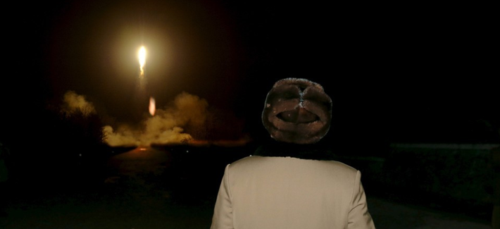 North Korean leader Kim Jong-Un watches a ballistic rocket launch.