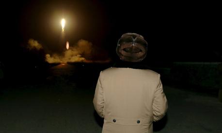 North Korean leader Kim Jong-Un watches a ballistic rocket launch.