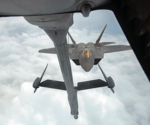 A U.S. Air Force F-22 Raptor approaches a U.S. Air Force KC-10 Extender from the 908th Expeditionary Air Refueling Squadron before aerial refueling during a Combined Joint Task Force - Operation Inherent Resolve mission Feb. 12, 2017.