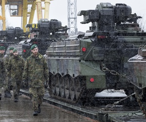 Troops from Germany's 12th Mechanised Infantry Brigade walks past Marder 1A4/3 military vehicles at the Sestokai railway station some 175 kms (109 miles) west of the capital Vilnius, Lithuania on Feb. 24, 2017.